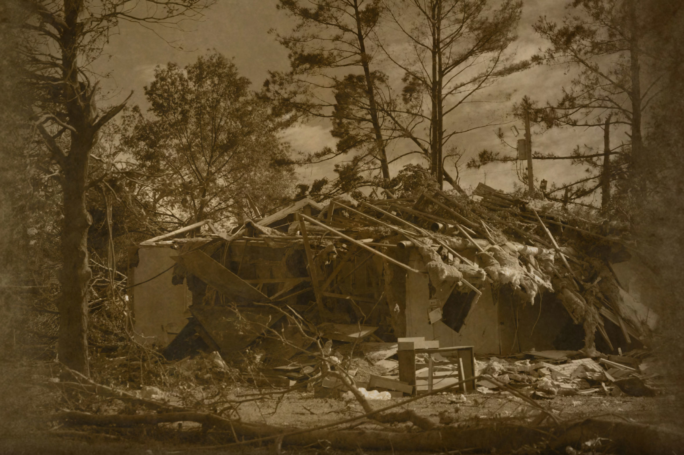 photo of a house destroyed by a tornado