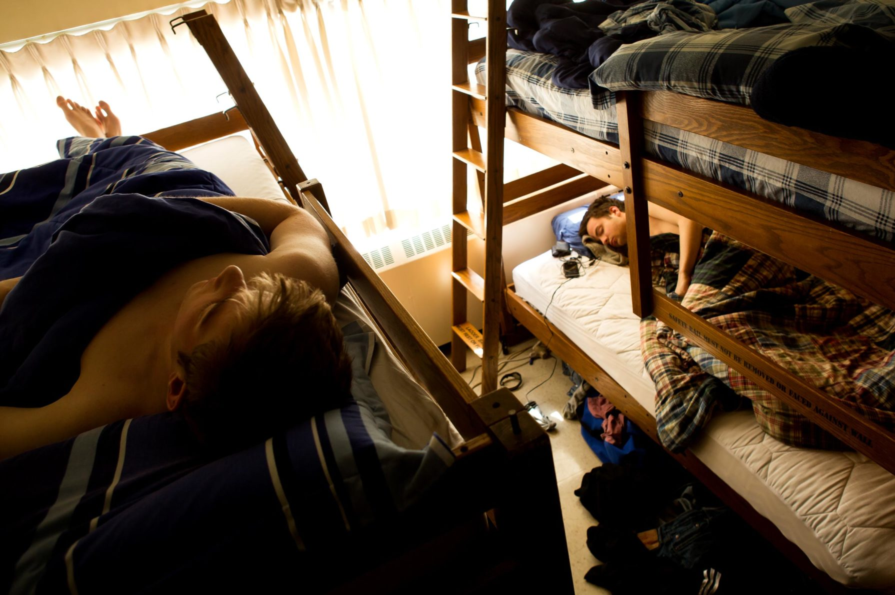 Students sleeping in bunkbeds