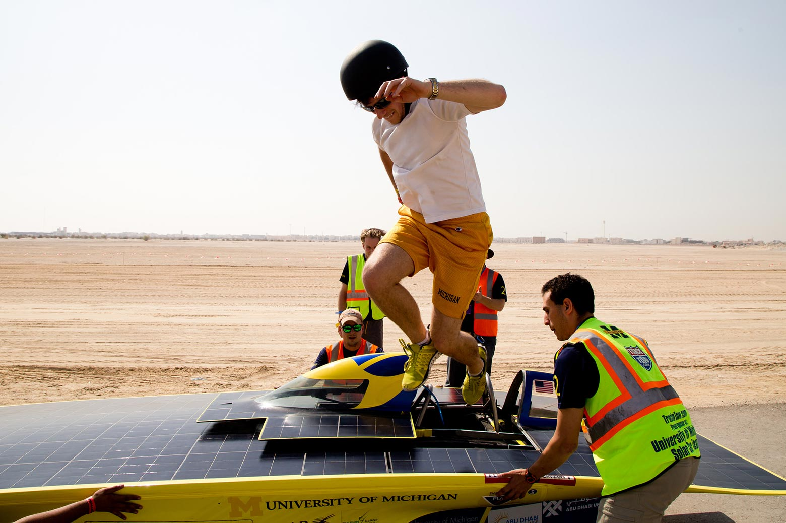Solar car driver jumps out of the car