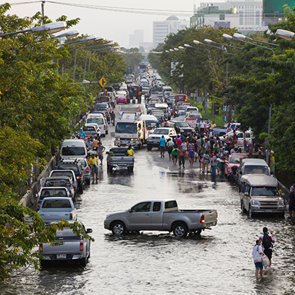 Residents attempting to evacuate a flooded city. Photo: iStock