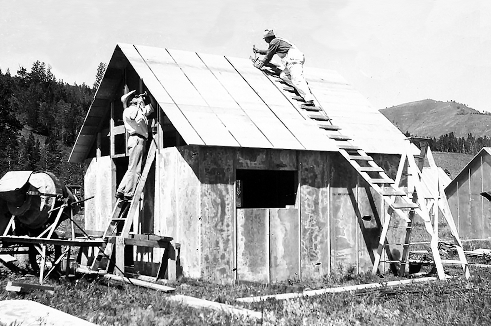 Men constructing a tin cabin at Camp Davis