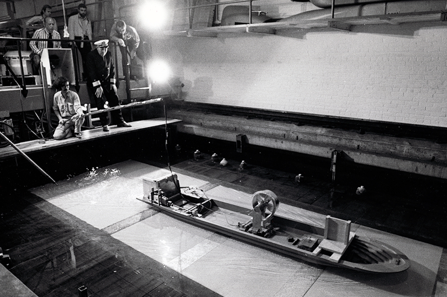 R.B. Couch and Ernst Wagner testing of paddlewheel design for proposed replica of Delta Queen steamboat circa 1960s.