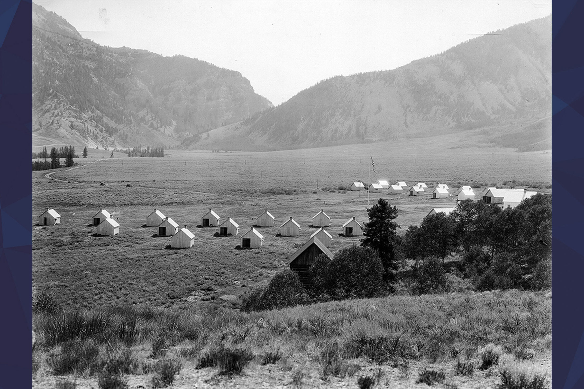 Field at Camp Davis with a bunch of small cabins in it
