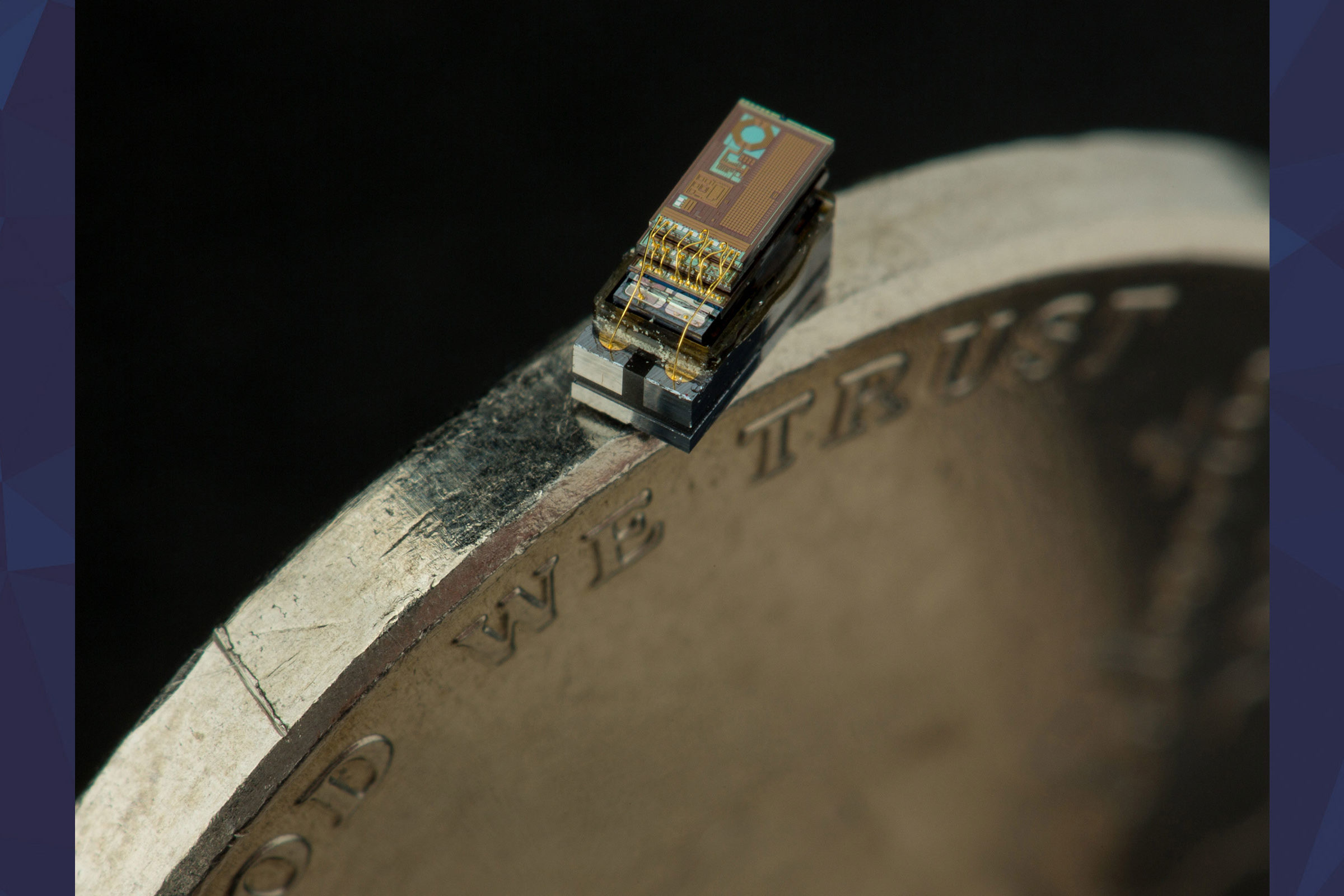 Micro computer sitting on the edge of a quarter
