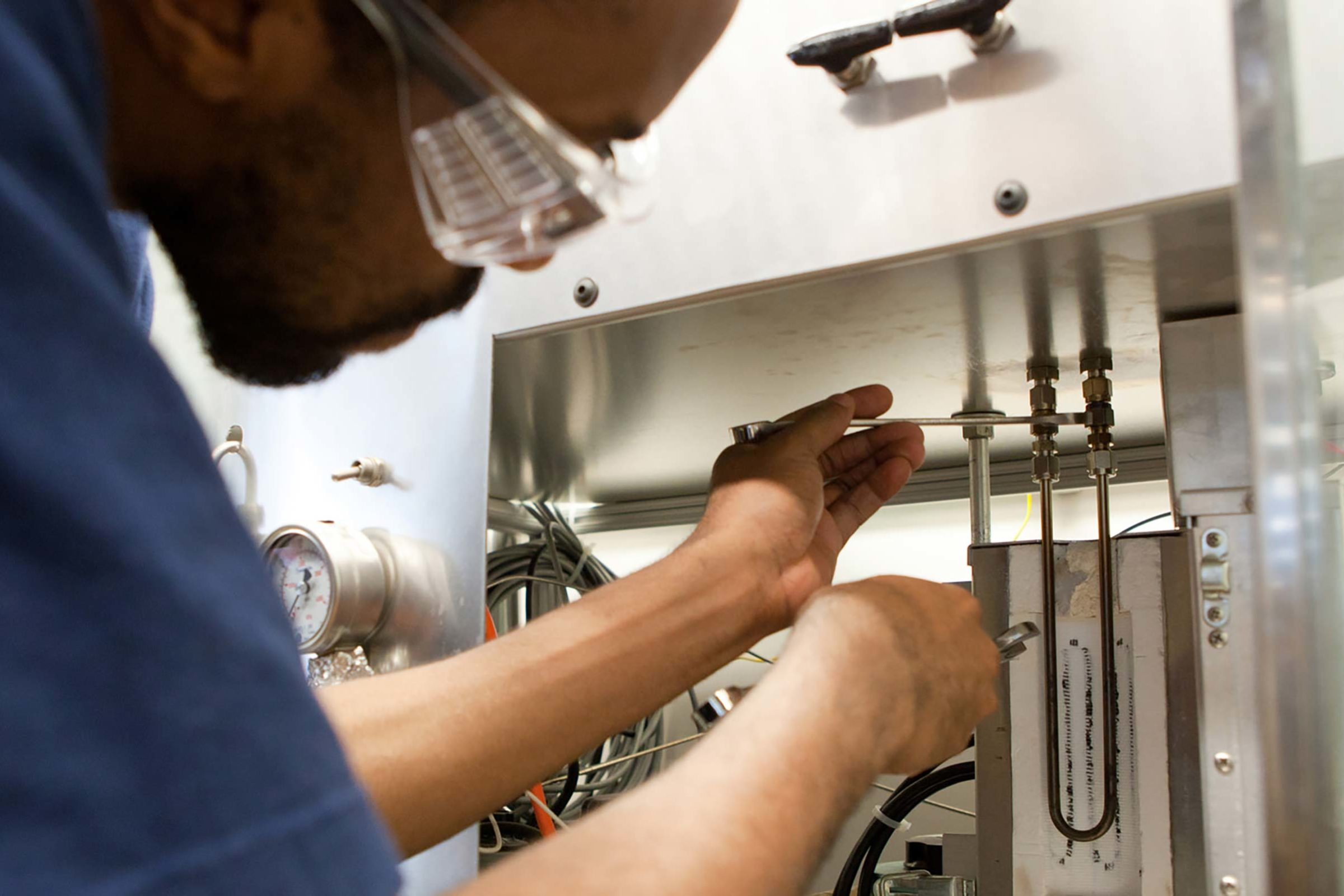 A graduate student works in a chemical engineering lab