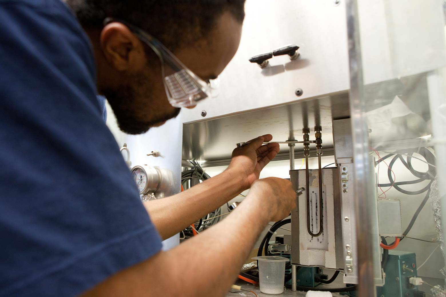 Graduate student works in chemical engineering lab