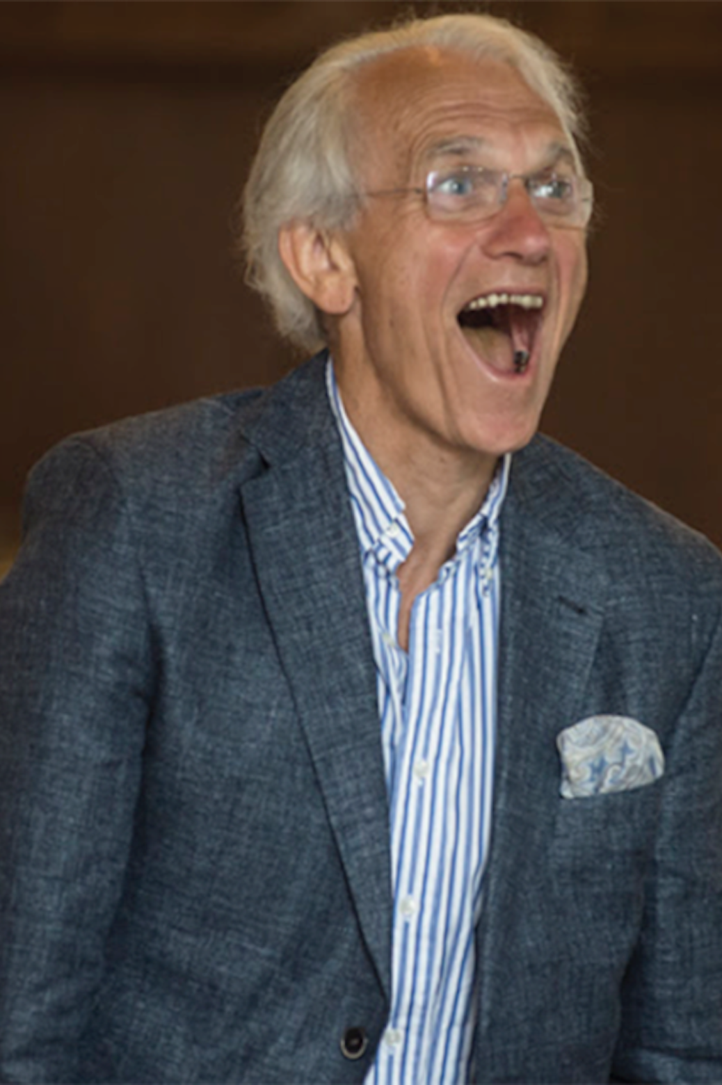 Gérard Mourou standing up with his mouth open