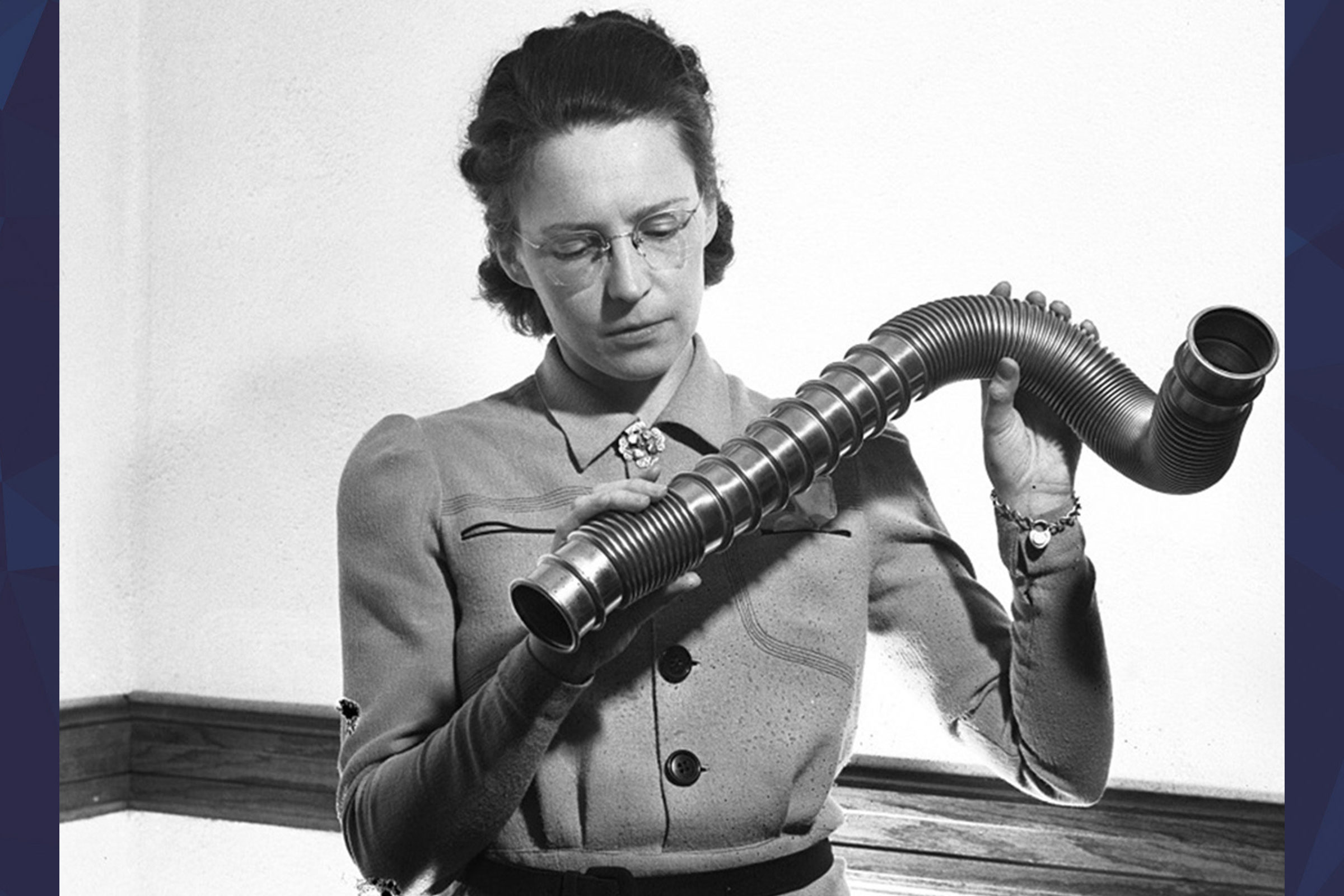Elsie MacGil holding up tube