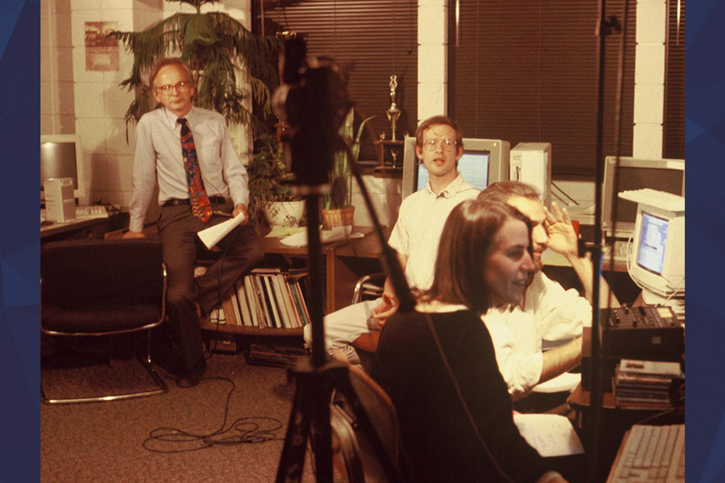 Wunderground team sitting in tv studio together