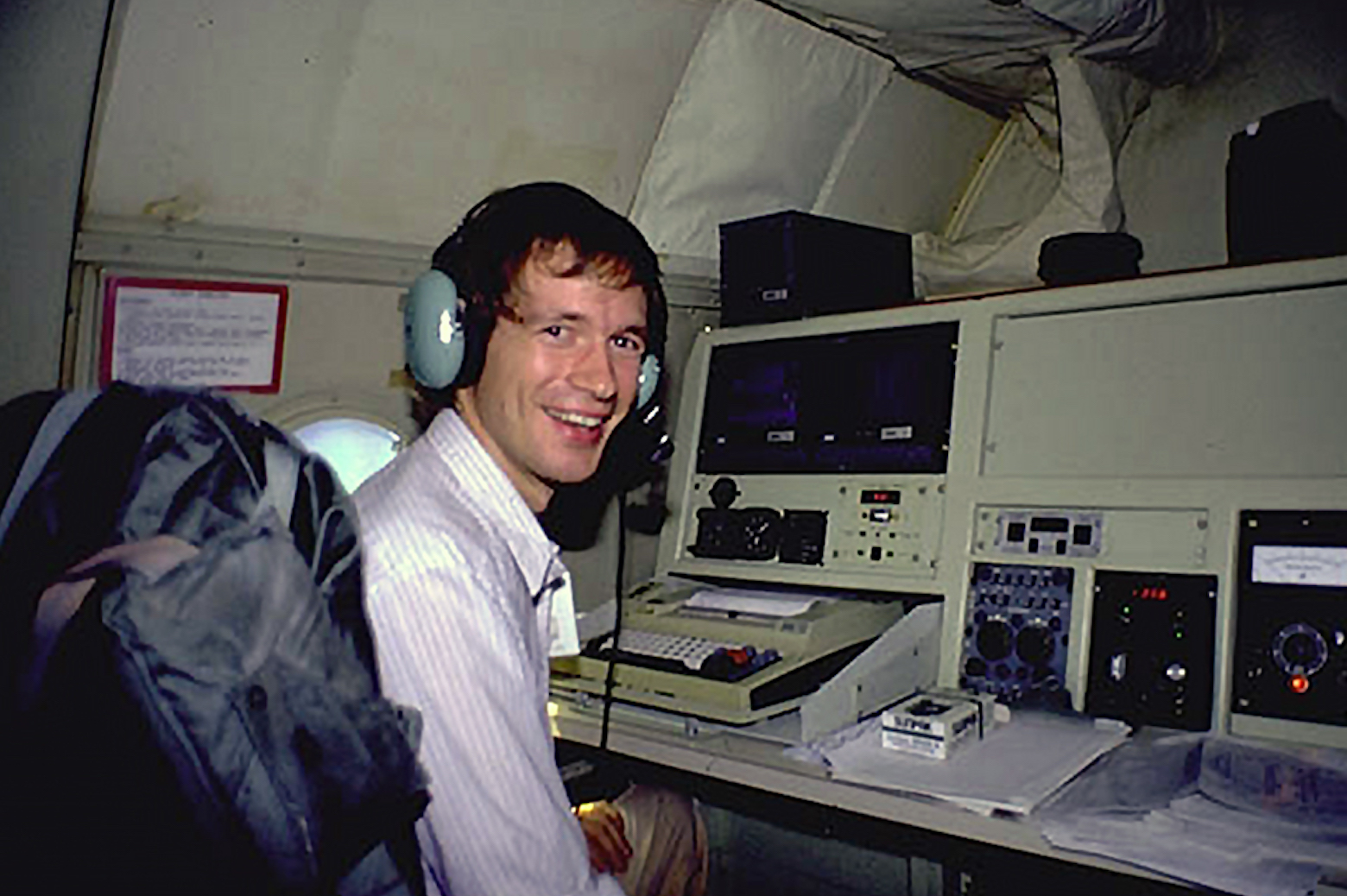 Jeff Masters at the flight director's station of the Hurricane Hunters' Lockheed P-3 Orion before taking off towards Hurricane Hugo.