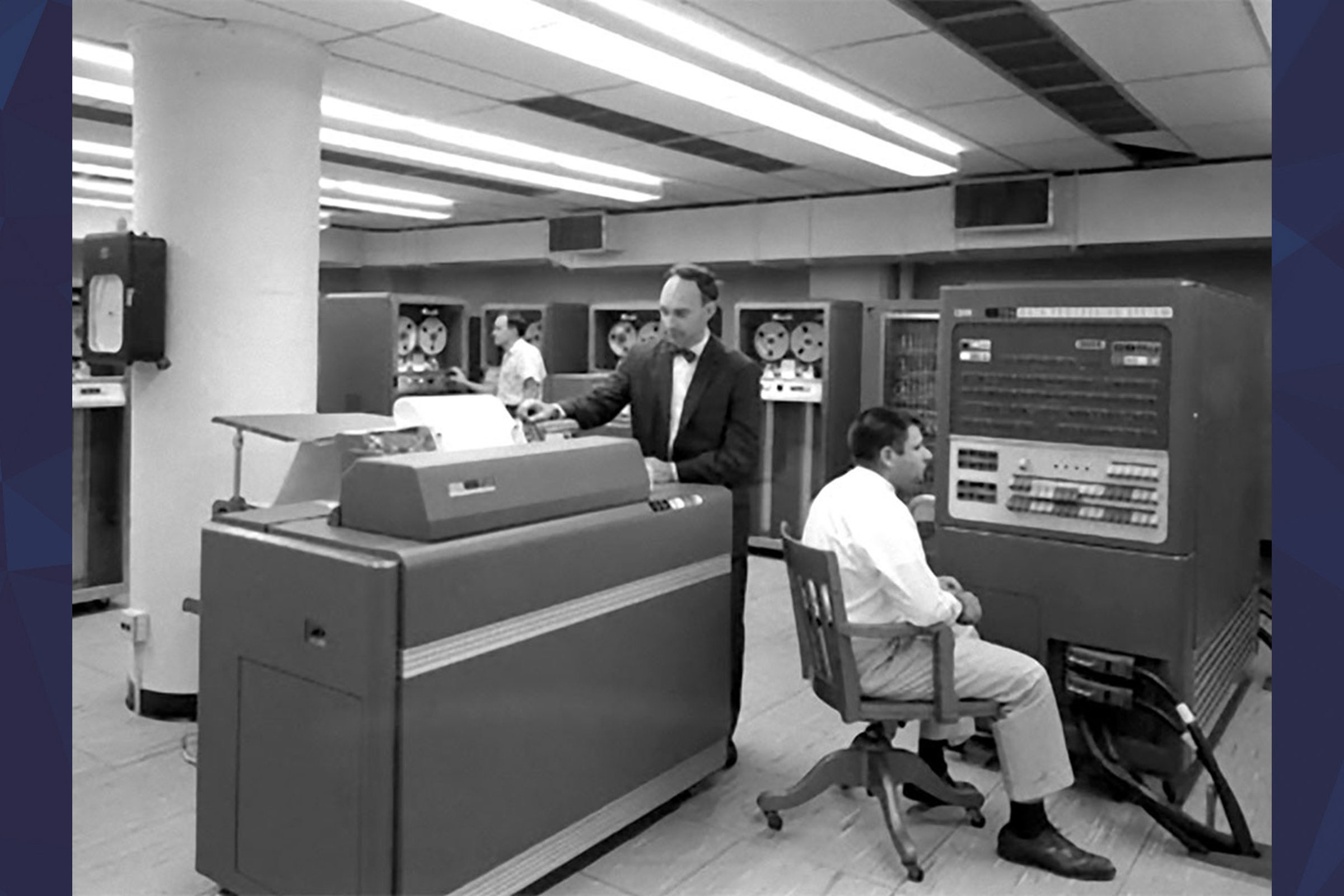 Two people with the IBM704 computer printer at the Computing Center