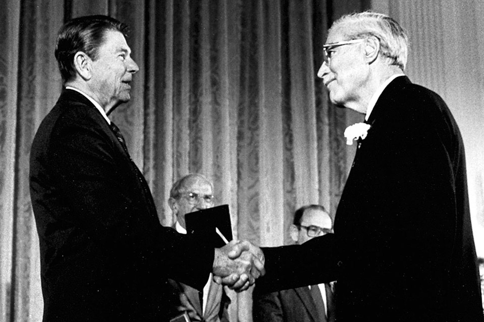 Donald Katz shaking hands with Ronal Reagan on stage