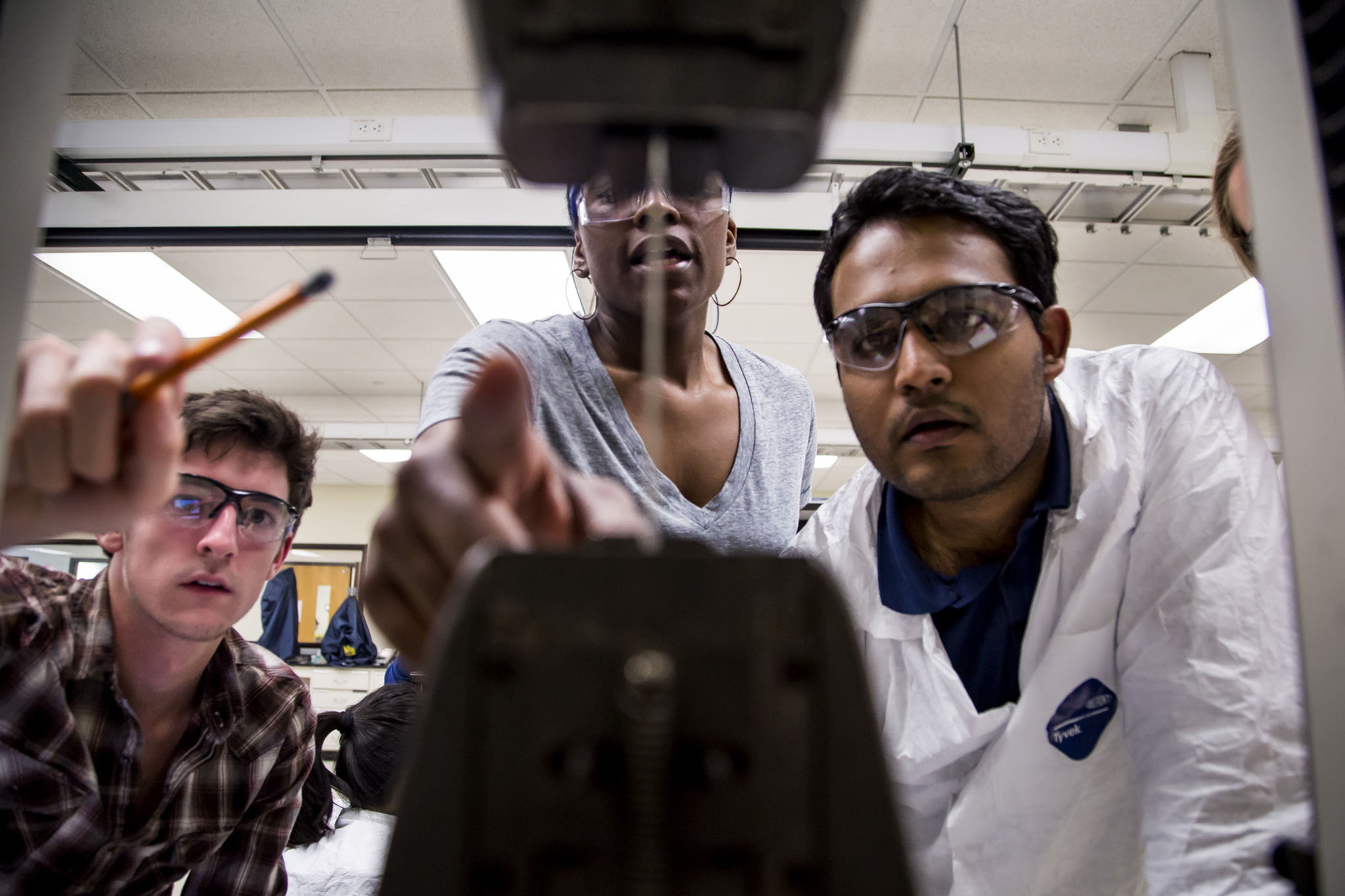 A photograph of Materials Science Engineering students testing the tensile strength of a variety of materials.