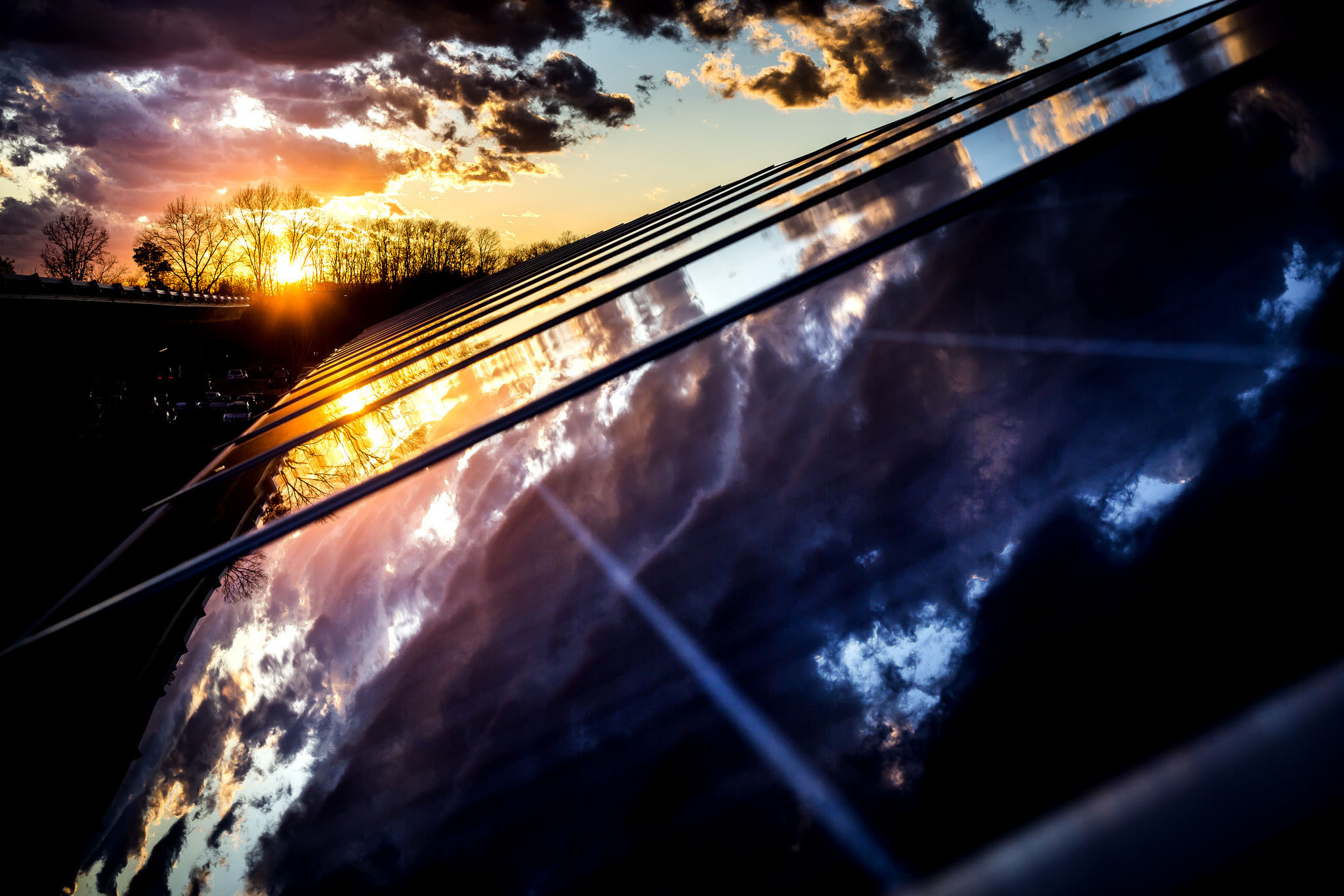 A photograph of reflections of dusk off of a solar panel.