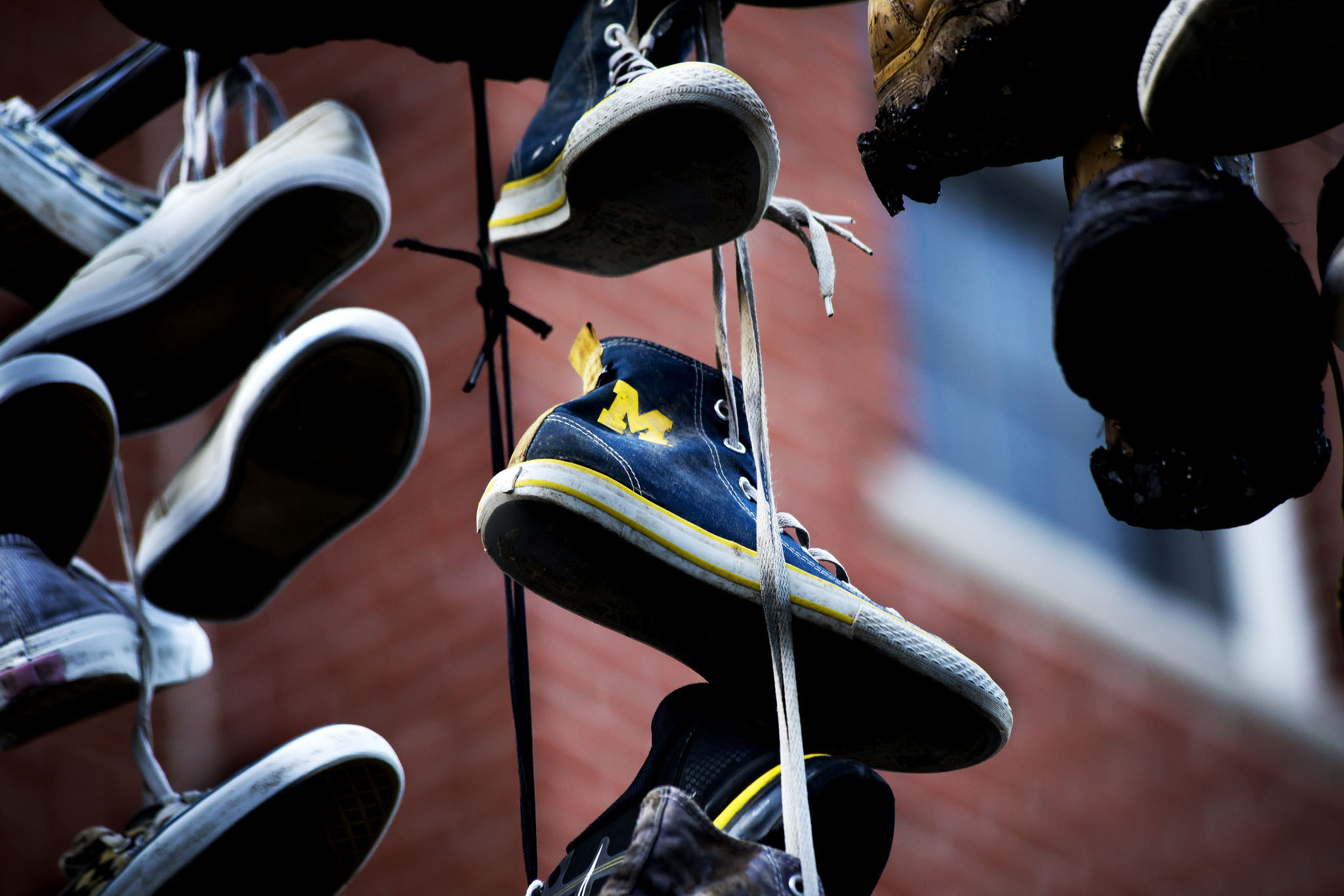 A photograph of shoes hanging on a power line.
