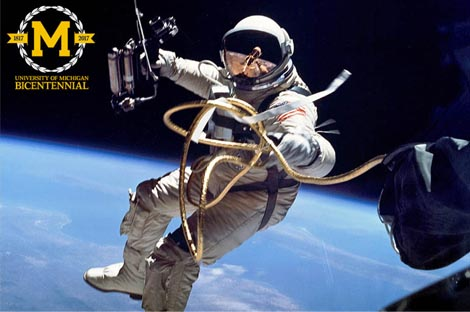 Alumnus and astronaut Ed White in space, floating above earth.