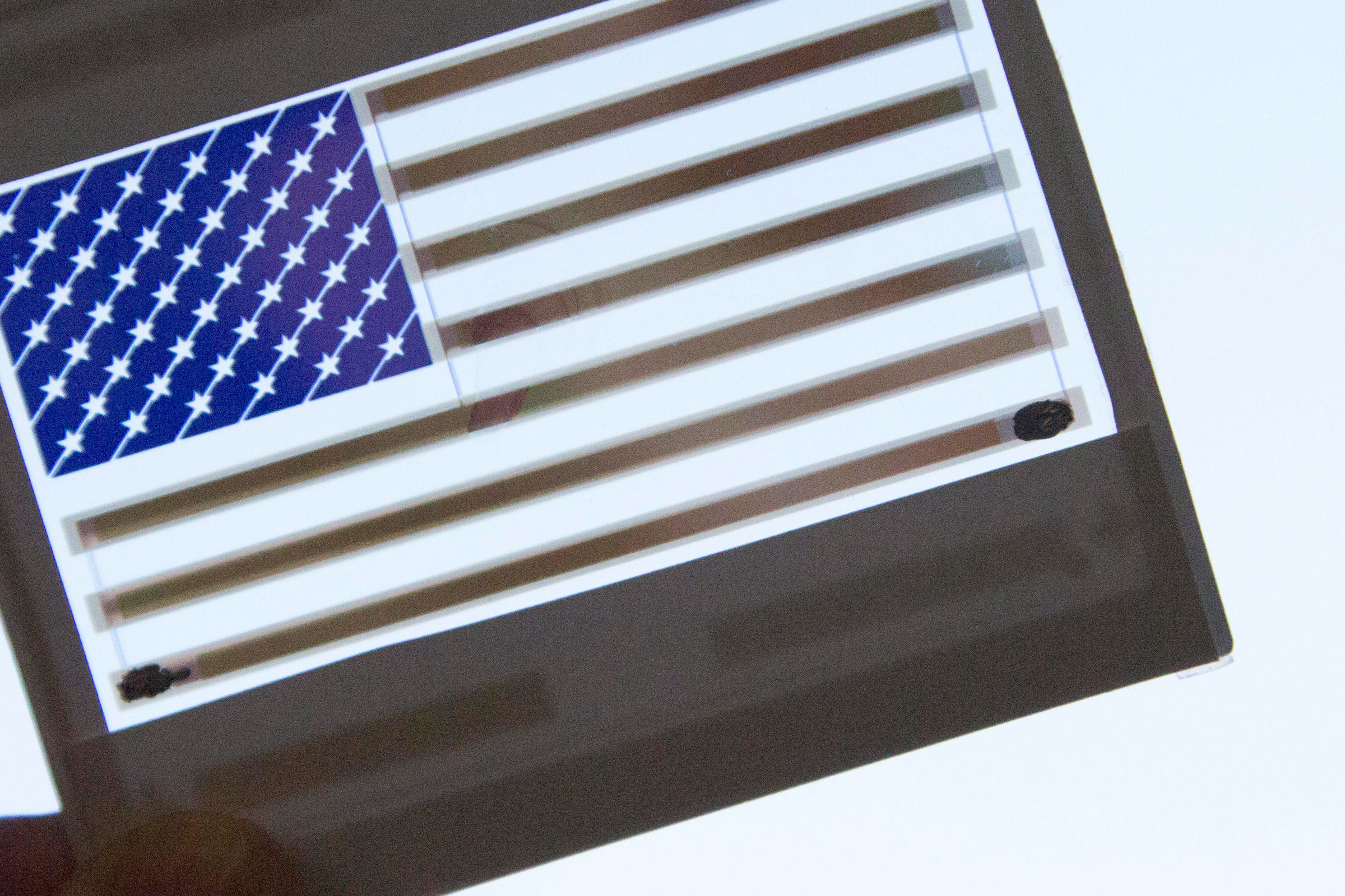 Colored solar panel with a flag image on it.