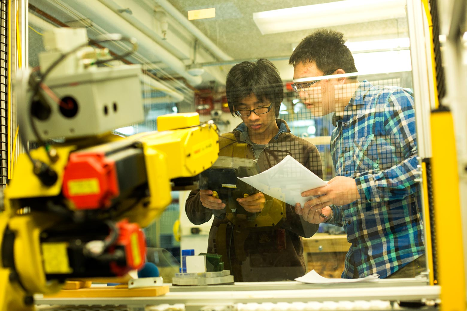 Zheming Zhang and Ming Huang work in the lab