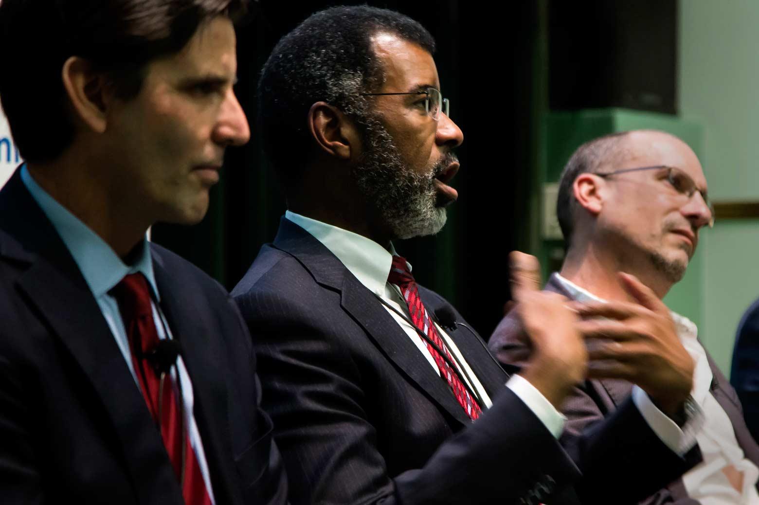 man speaking as part of panel