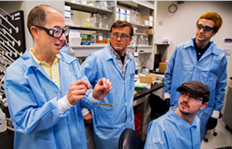 Richard Schwartz, Chief of the Vaccine Production Program at the National Institute of Health Vaccine Research Center, chats with members of his lab/ Photo: Joseph Xu, Michigan Engineering