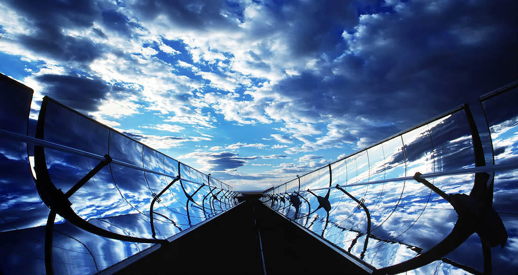 A dramatic image of parabolic trough solar collectors.