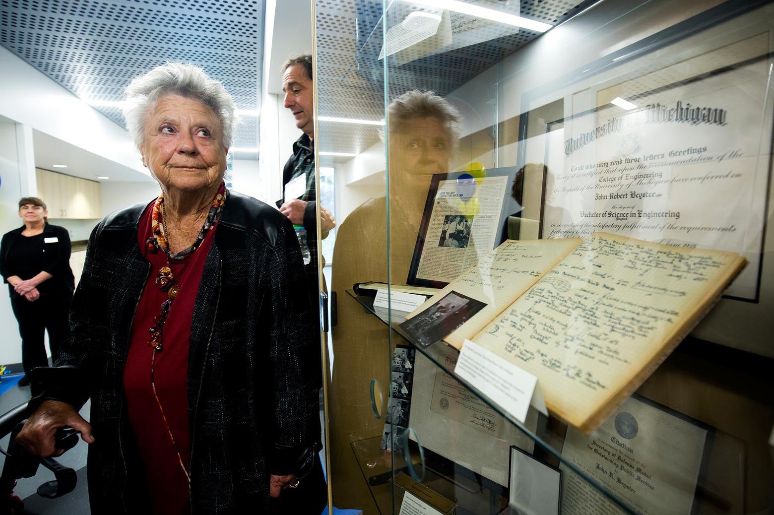 Betty Beyster views a showcase