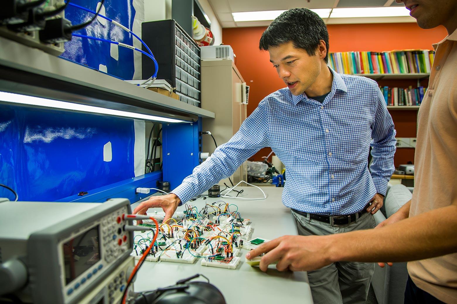Scientist examines accelerometer sensor