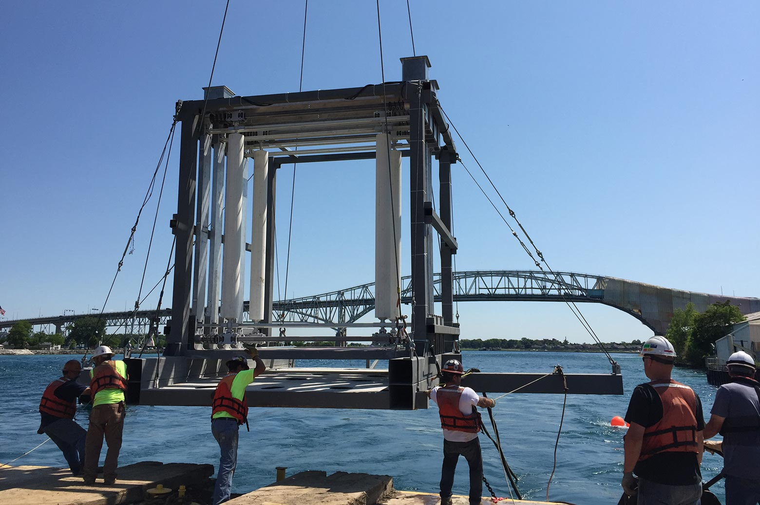Workers prepare to lower the Vivace device into the St. Clair river at the beginning of the field test in June of 2016.
