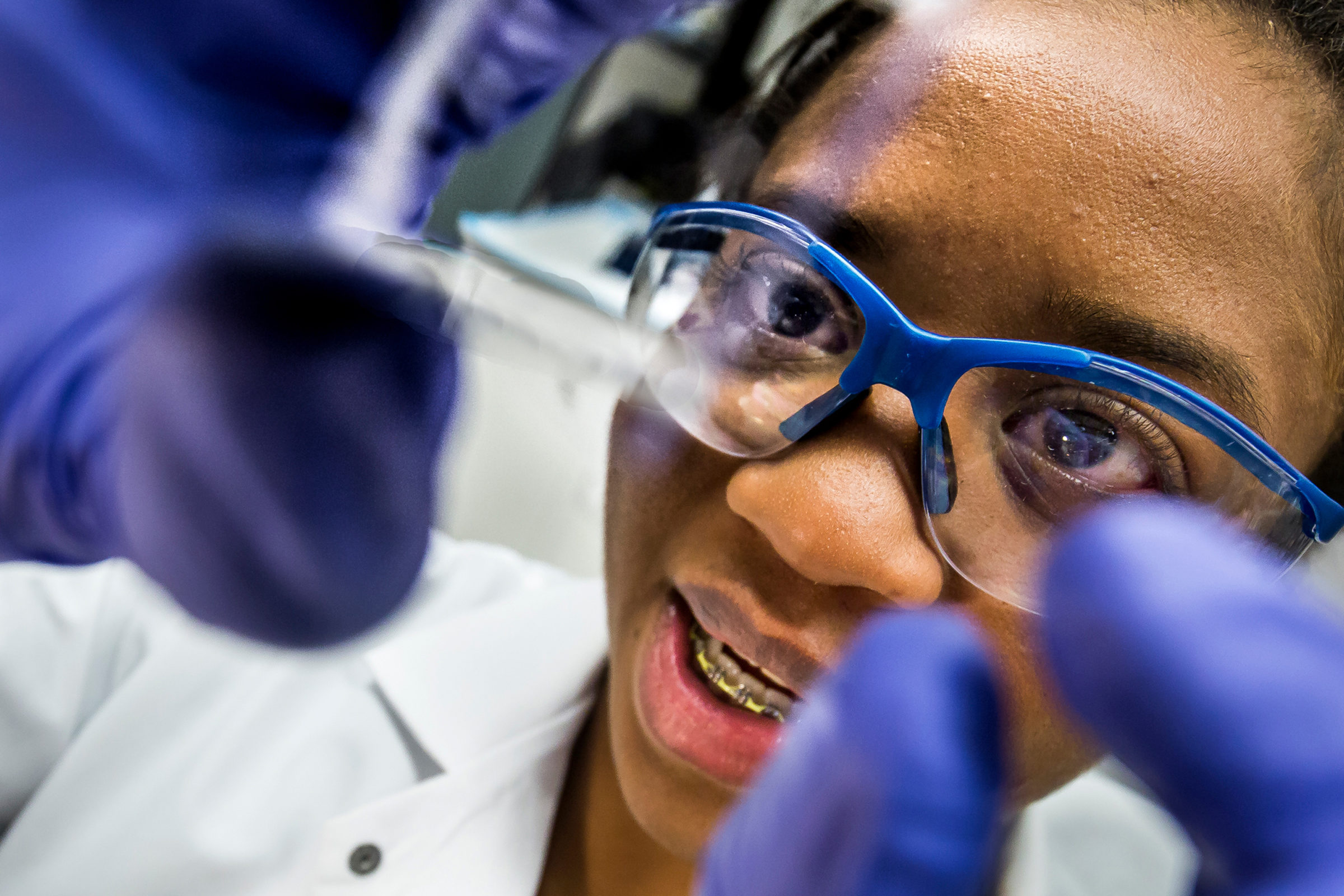 Rhonda Jack looks through a slide in the lab. Photo: Joseph Xu, Michigan Engineering Communications & Marketing.