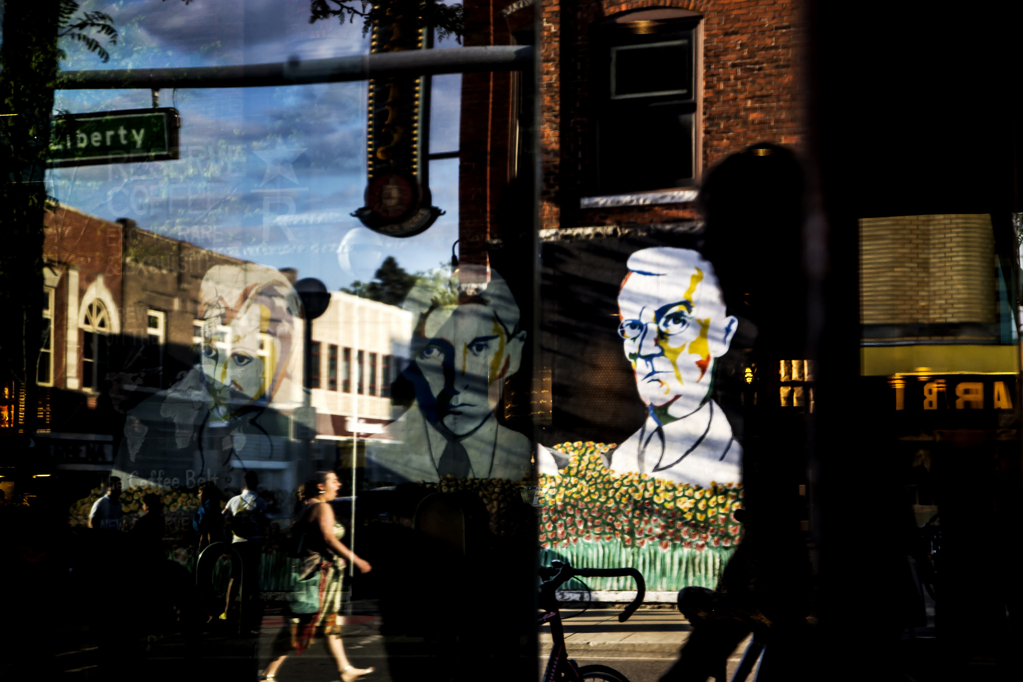 A photograph of reflections of State St. at the Corner of State St. and E. Liberty