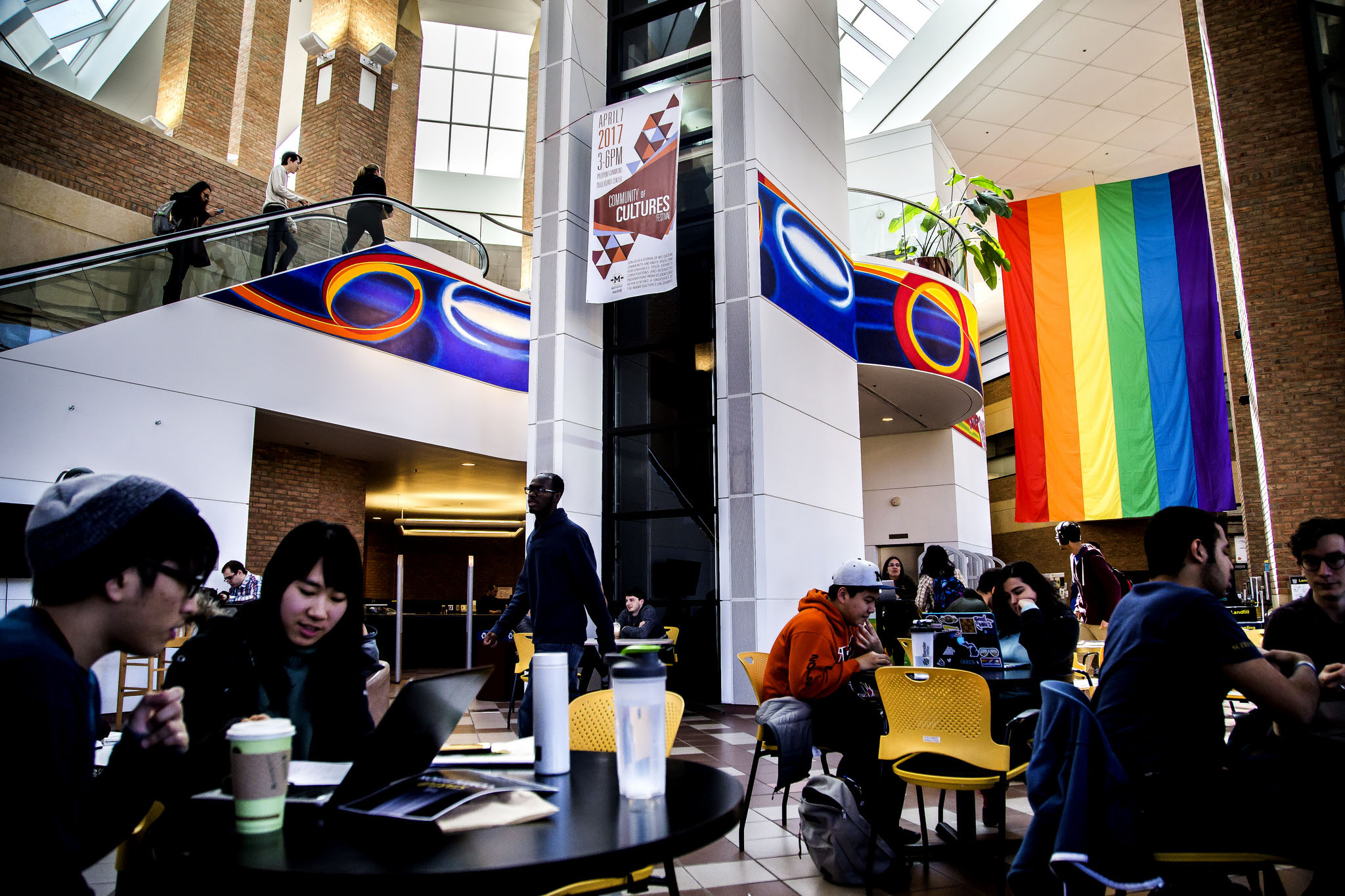 A photograph of a pride flag hanging in the Duderstadt Center on North Campus of the University of Michigan