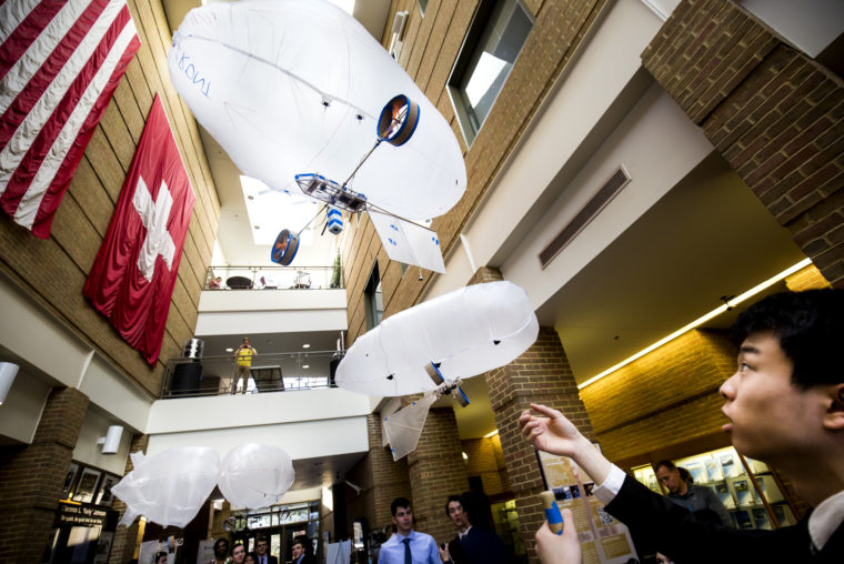 A photograph of a student flying a blimp during the annual Aerospace Day in the FXB Atrium.