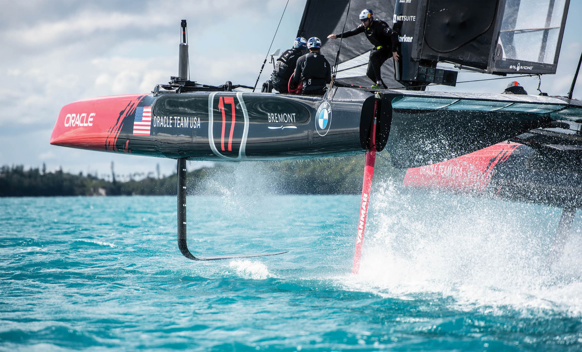 """ORACLE TEAM USA's AC45 catamaran uses hydrofoils to """"fly"""" above the water."""