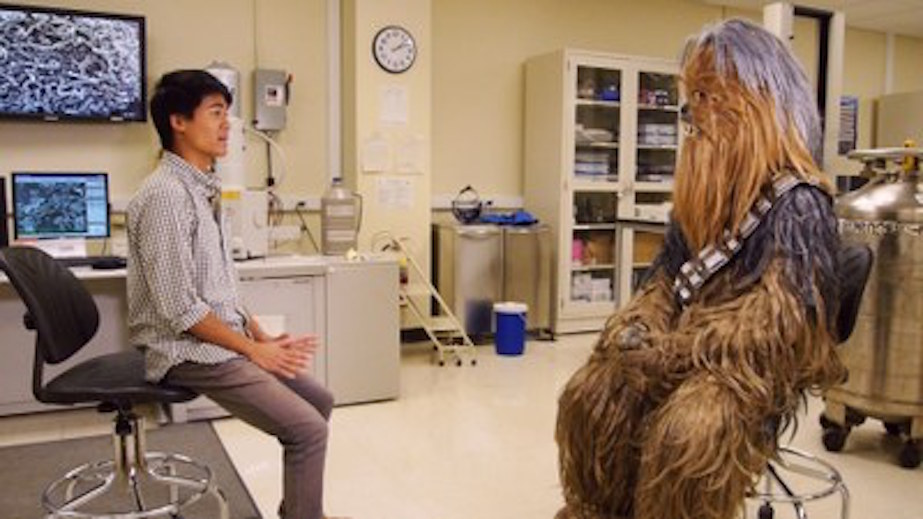 Timothy Chan, senior, talks with Chewie about instantly freezing a person like Darth Vader did to Han Solo.