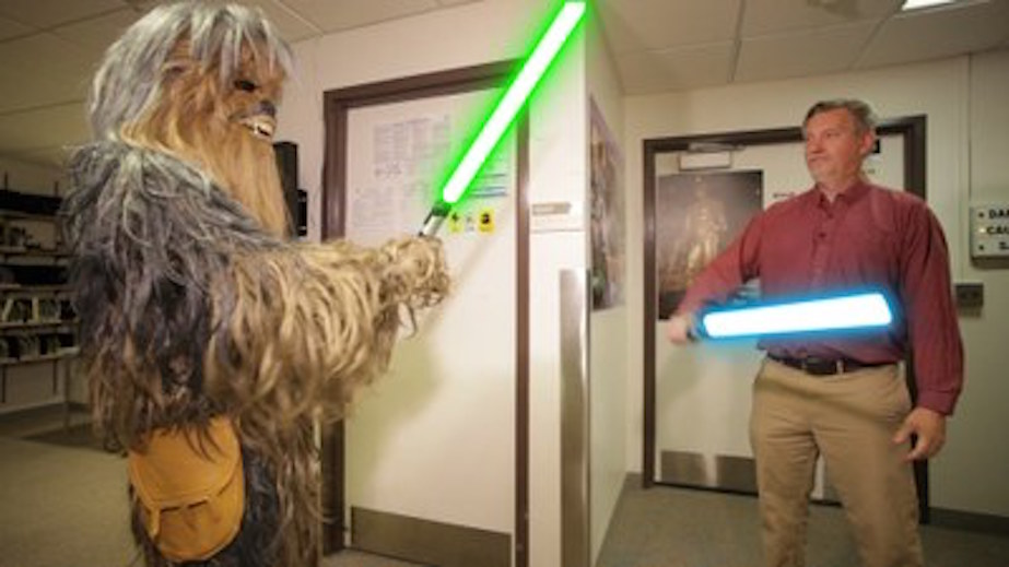 Karl Krushelnick and Chewie with light sabers
