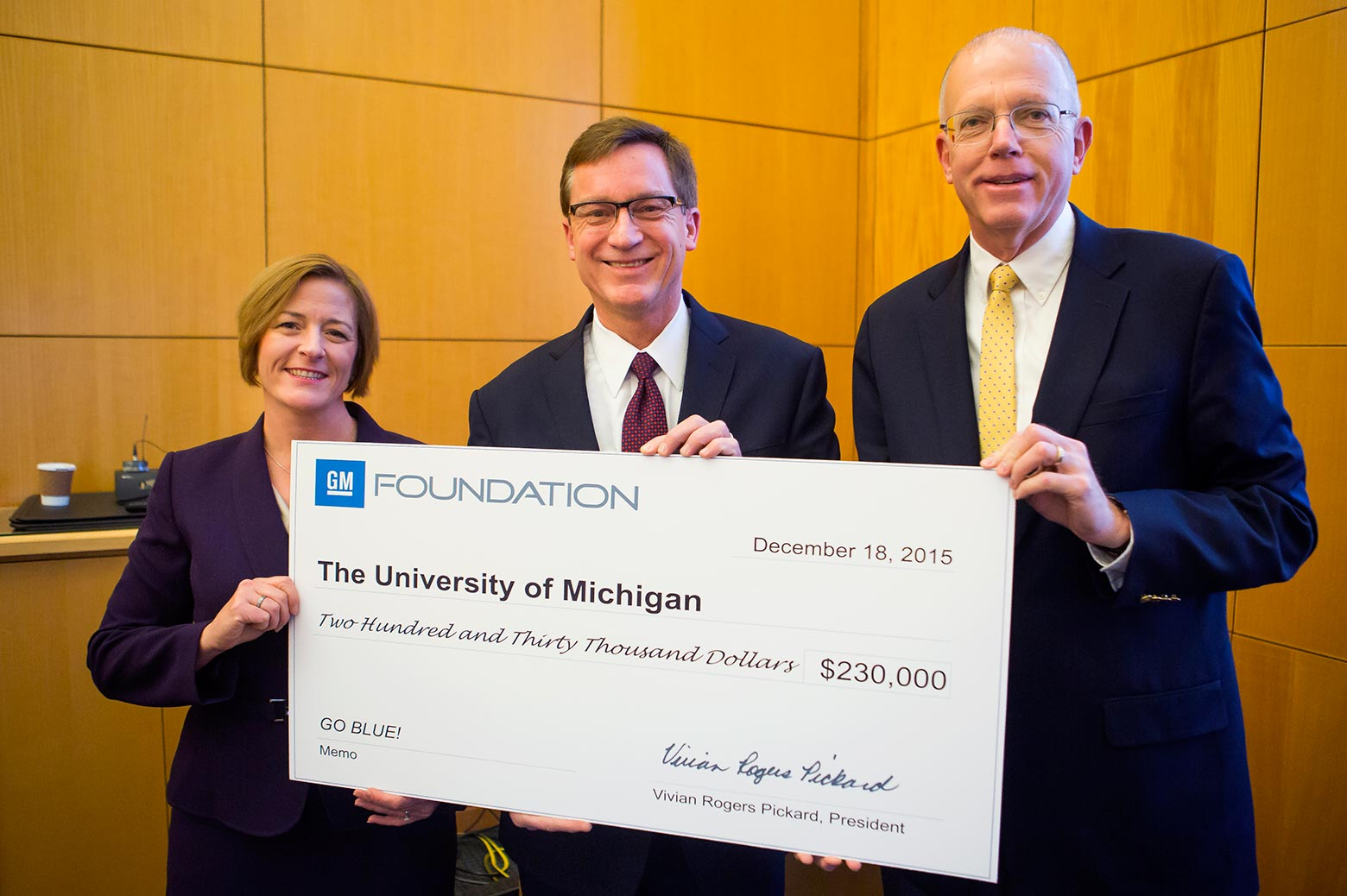 Large check is presented to representatives from U-M