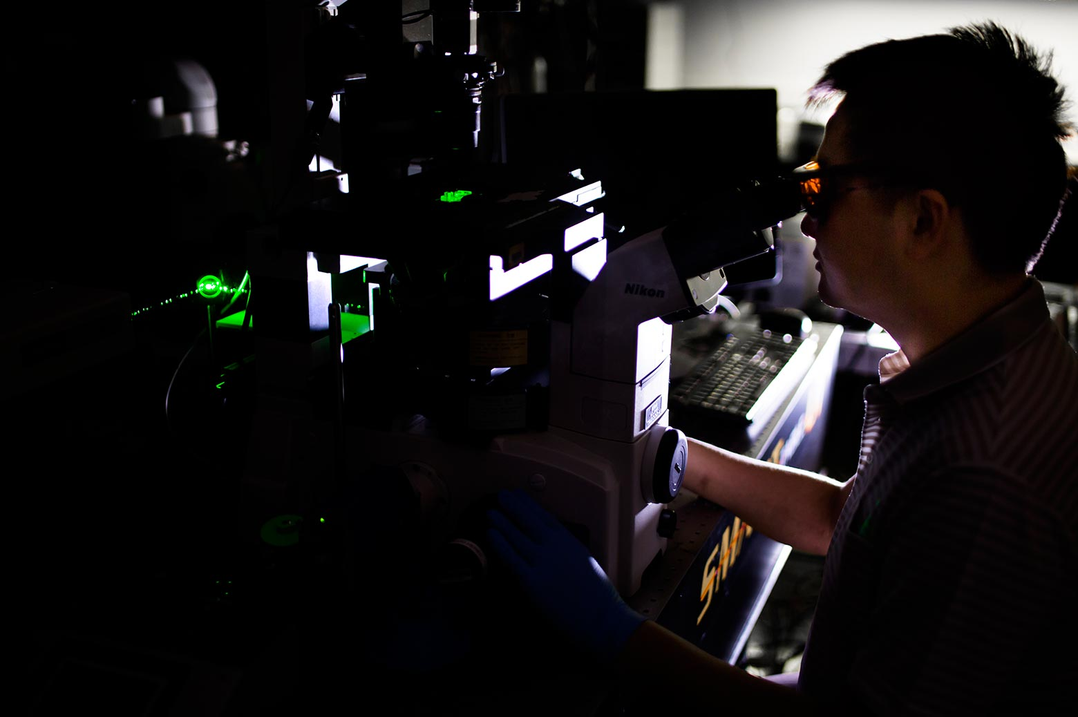 Scientist at work in a dark lab