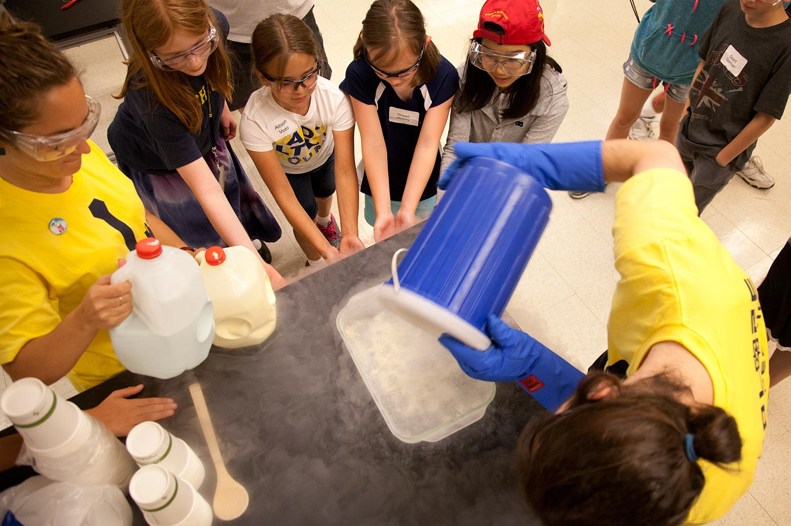 Children around a table doing a scientific experiment
