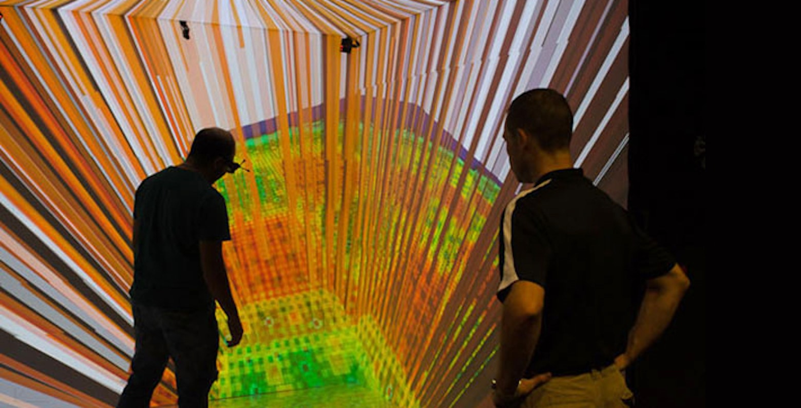 researchers walk among the fuel rods of a virtual reactor