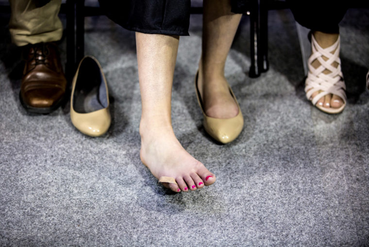 A photograph of a student resting her foot at the 2017 Michigan Engineering Spring Graduation Ceremony