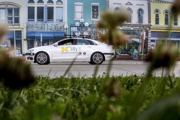 A photograph of an autonomous car in MCity, a new autonomous vehicle testing facility.