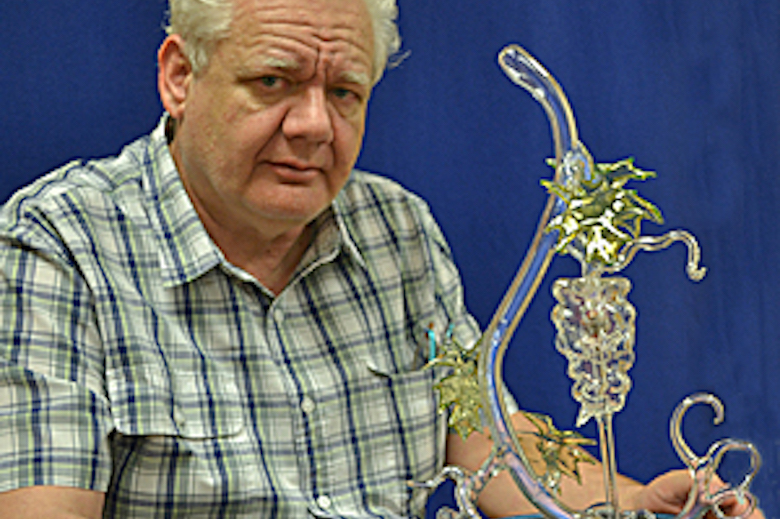 Harald Eberhart posing with the glass blown sculpture made by him.