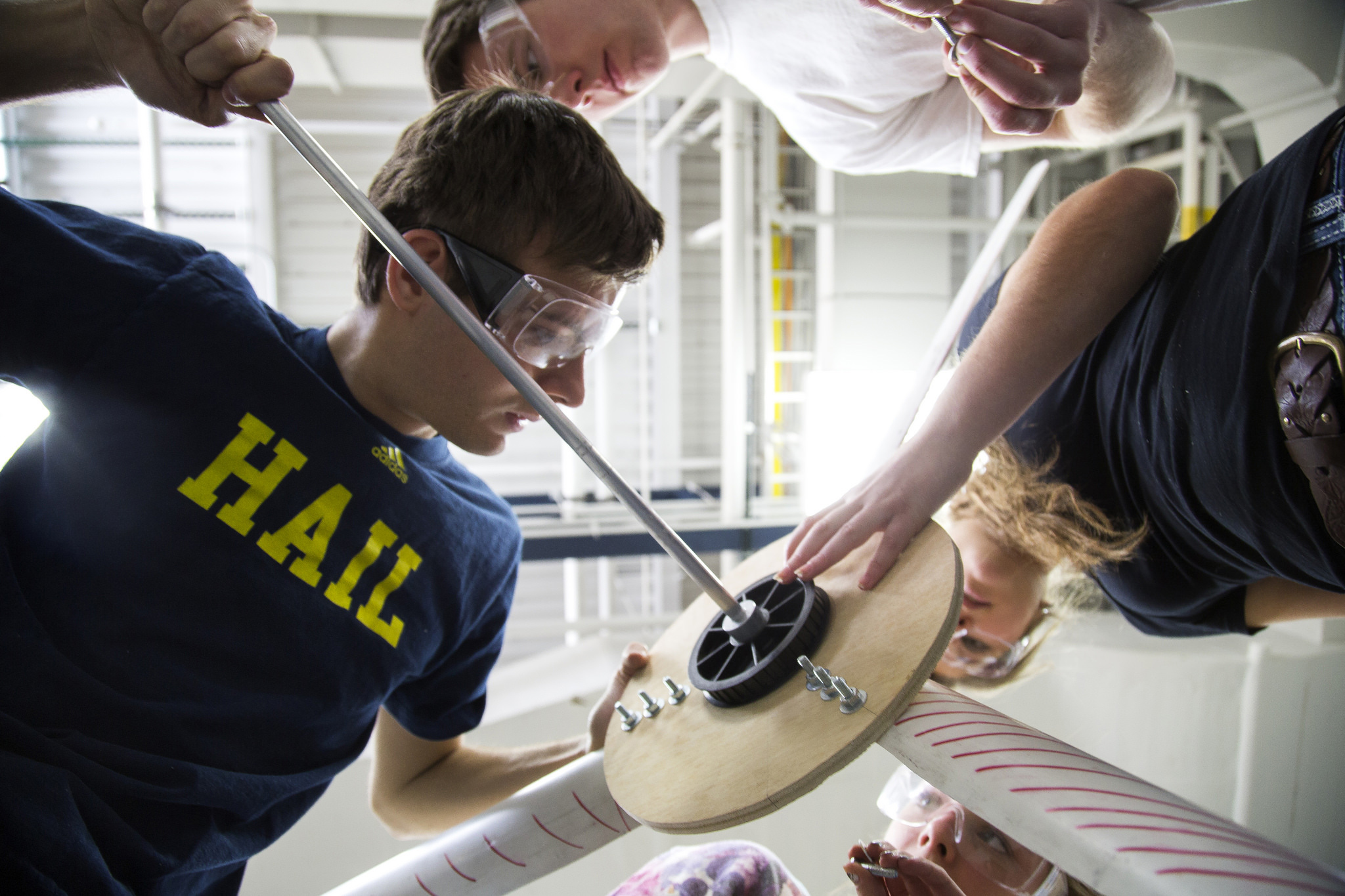 A photograph of a student team working on a wind turbine.