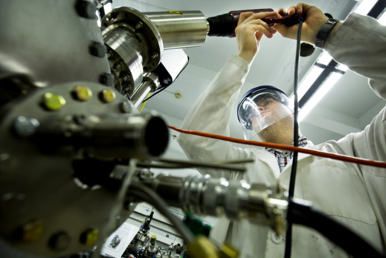 A photograph of a researcher in the Michigan Ion Beam Laboratory.