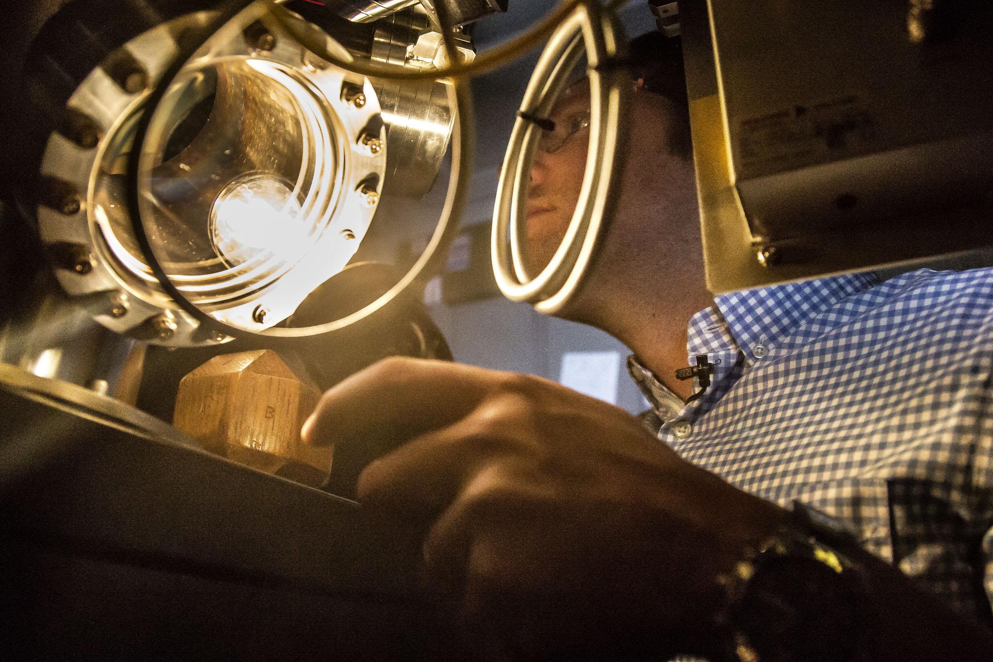 A photograph of Professor John Heron inspecting an oxide film.