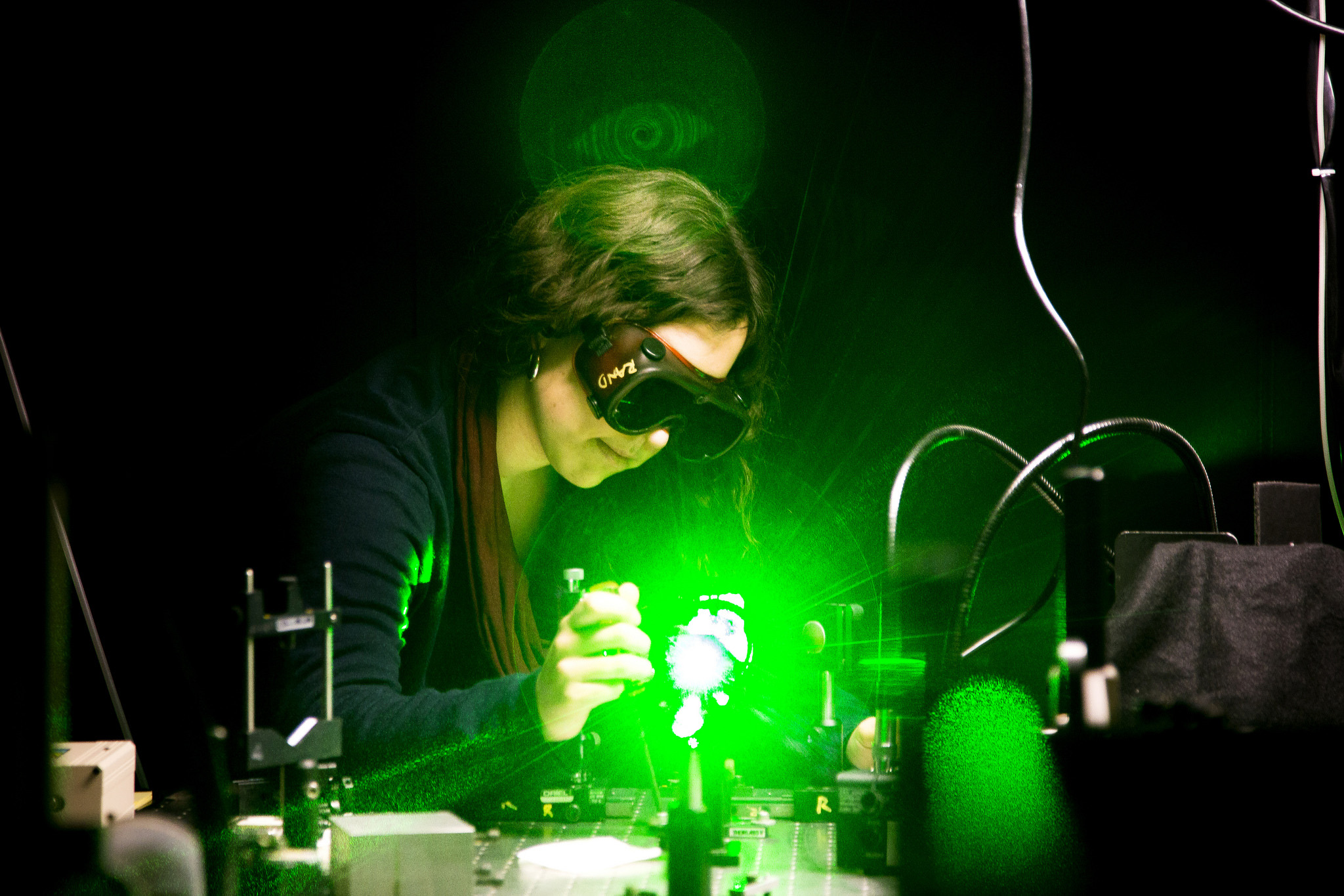 A photograph of a EE student working with lasers.