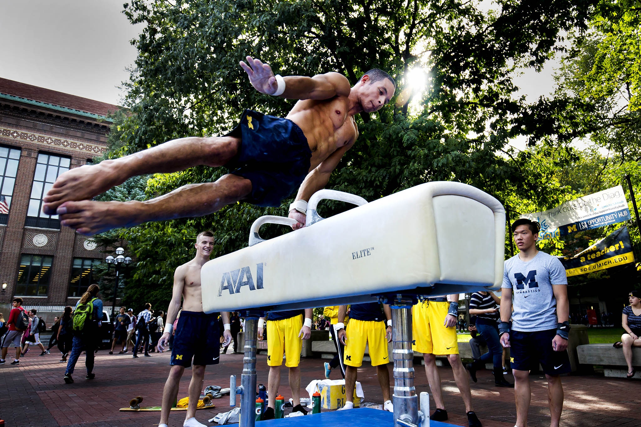 A photograph of Tristan Perez-Rivera, EE BSE Student, performing on a pommel horse on the Central Campus Diag in Ann Arbor, MI.