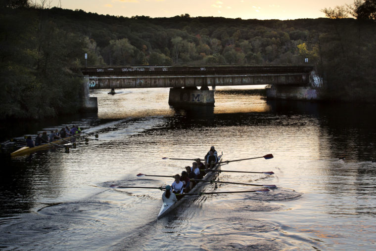 A photograph of a rowing team on the Huron River.