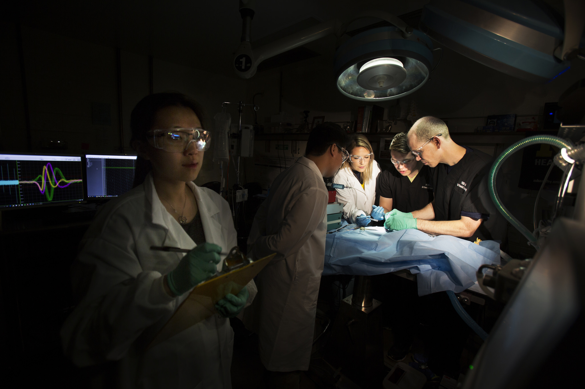 A photograph of BME researchers performing surgery on a sea slug.