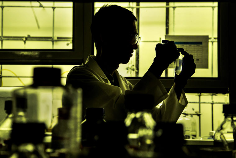 A photograph of ChE BSE Student, Harrison Hou, working in the lab on North Campus.